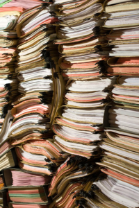 Document Storage filing system with issues, this is not a safe way to store your valuable business documents.