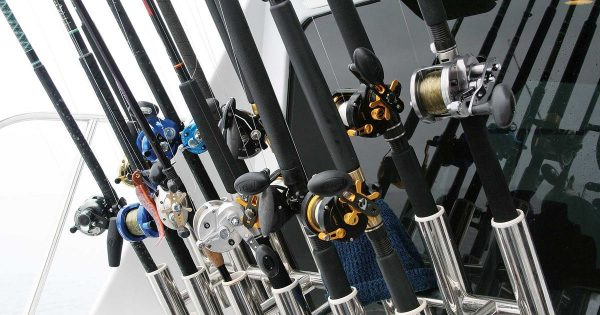 a line of fishing rods on a boat