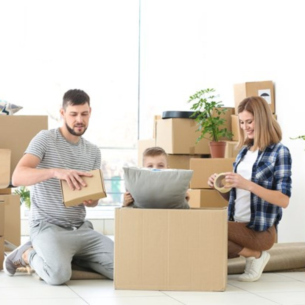 A young family happily packing up for a move