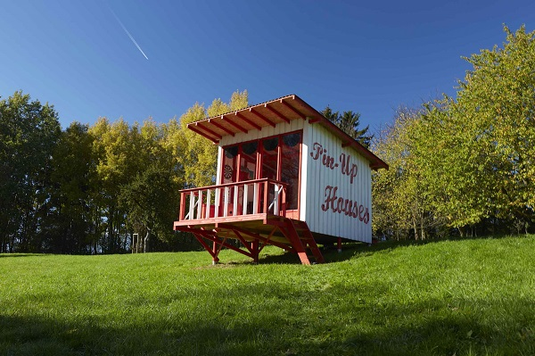 A tiny pin-up home on a field